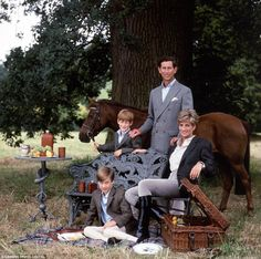 Prince Charles Diana, Princess of Wales, Prince William and Prince Harry are captured enjo...