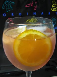 1 (750 ml) bottle rose wine , chilled      1/4 cup brandy      1/4 cup orange liqueur (Cointreau, Grand Marnier)      2 cups white cranberry juice      1 orange , sliced      1 lemon , sliced      12 fl oz Sprite (or other citrus flavoured soft drinks)       In a pitcher, combine all the ingredients except the soft drink and ice cubes.    Refrigerate for 1 hour. Add the soft drink and ice just before serving.