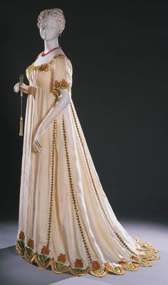 dress Made in England, Europe c. 1805-1810, Ivory silk plain weave with multicolored silk embroidery in padded satin, buttonhole, and whipped running stitches and French knots, Center Back Length: 58 1/2 inches (148.6 cm) Philadelphia Museum of Art