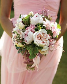The bride's bouquet, created by friend and Martha Stewart Weddings style director Kate Berry, includes pale-pink garden roses, jasmine, succulents, and a swath of ribbon to match Jen's dress.