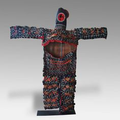 SPIRIT DANCE COSTUME, BASED IBIBIO PEOPLE IGBO PEOPLE 20TH C. COTTON PATCHWORK AND APPLIQUE 71'' W x 6'' D x 75'' H -  The brightly colored costumes are made and danced by mature men in their late 20's through 50's. The bright patterns of the full body costume, made up of different colored cloth appliqued and detailed design patterns, represent the patterns of body paintings called uli.
