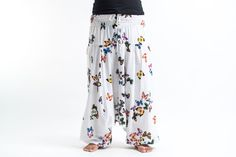 "These magical Low Cut Harem Pants can be converted into a jumpsuit. It's like buying one outfit but getting two. They are great for lazy Sundays, doing yoga, or hula hooping at a music festival. Free international shipping on all orders over $60.   Measurements:  Waist: 32"" to 44"" Hips: up to 46"" Total length: 43"""