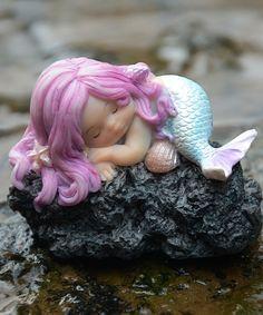 Take a look at this Sleeping Mermaid & Rock Figurine today!