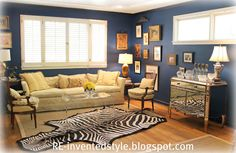 dark blue living room walls - benjamin moore, zebra skin rug over seagrass rug and mirror chest