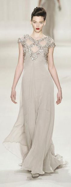 Chanel couture gown. Flowing silk chiffon in bone. Geometric beaded silver top detail. Beautiful!