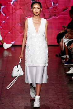 The runway ended with a parade of all-white looks, each varied in volume, detail and shape. One cocktail dress featured cut-outs at the waist and was super pretty, while the final look, a neoprene baseball jacket and skirt with fringed detail at the waist blurred the lines between sporty and girly.   - HarpersBAZAAR.com