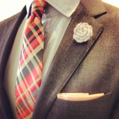 Excellent bold tie and the lapel flower is a signature touch.