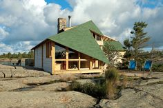Katja and Adam Thom's cabin, on an exposed postglacial archipelago in Canada's windswept Georgian Bay, is more than eight miles from the nearest road. Published in Dwell Magazine, Nov 08. Photo by: Mark Giglio | Read more: http://www.dwell.com/articles/on-the-rock.html