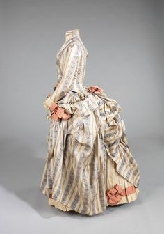 A lovely 1885 bustle gown.  This would be a good design for a costume.