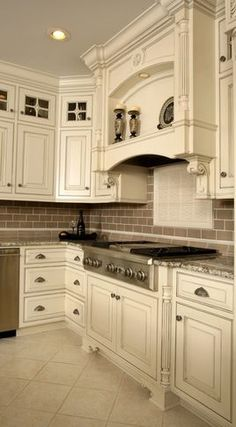 I love everything except that tile backsplash. light cabinets, light floor, tan backsplash, tan walls, pretty granite.