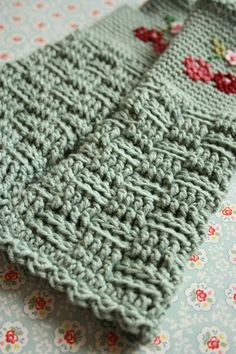 Finally a pair of crocheted fingerless mitts that I really like the looks of!! by Cherry Heart