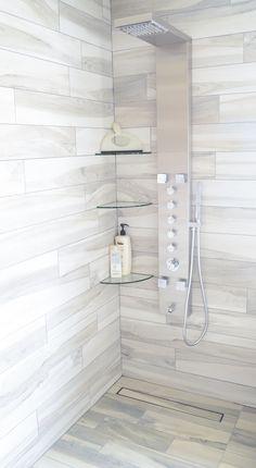 Photo contest finalist. Sleek, modern shower featuring LUXE Tile Insert Linear Drain.