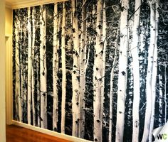 Creating an entry hallway you look forward to seeing when you arrive in after a long day of work - this black and white forest wall mural adds some interest and excitement to a front entry in Melbourne!
