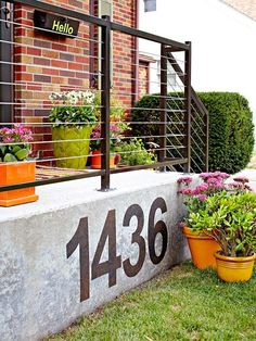 Make a statement and your house number clear to all! Contemporary look for the exterior of a home complemented by bright orange and lime pots and stylish railings - definite kerb appeal.