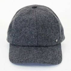 This wool cap (made in the US!) is a great year round style. Perfect with a loose tee and boyfriend jeans. $36 on www.mooreaseal.com