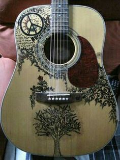 Beautiful guitar personalised with art. A story to carry with you