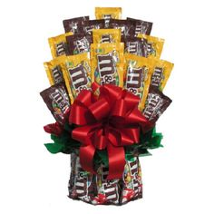 Chocolates & More Candy Bouquet - Chocolate really is the foundation from which all other candy springs, as proven by the Chocolates & More Candy Bouquet . This incredible candy bouquet. Bouquet Cadeau, Gift Bouquet, Boquet, Candy Arrangements, Candy Centerpieces, Centerpiece Ideas, M M Gifts, Food Gifts, Candy Bar Bouquet