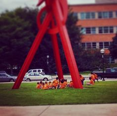 Spotted: adorable, orange-clad children playing duck-duck-goose around 'Orion'