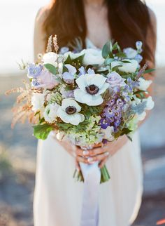 Beautiful bouquet: http://www.stylemepretty.com/canada-weddings/2015/04/17/sunset-vancouver-beach-engagement-session/   Photography: Vasia Han - vasia-weddings.com