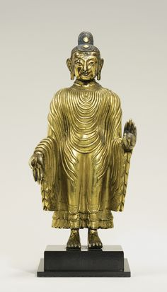 A Gilt Copper Alloy Figure Depicting Udayana Buddha Height: 6 1/2  in. (15.1 cm) China, Qing Dynasty, Qianlong period