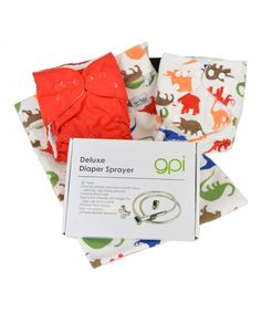 Welcome the world of eco-friendly diapering into the home with this starter kit. Just what parents need to begin outfitting Baby with reusable diapers, it features two microfleece-lined pocket diapers—one with a minky shell—that adjust to grow with Baby, four antibacterial inserts for maximum absorbency, a wet bag for stashing used diapers, one roll of bamboo liners and a GPI diaper sprayer for easy cleanup. Includes two pocket diapers, four inserts, wet bag, GPI diaper sprayer and 100…