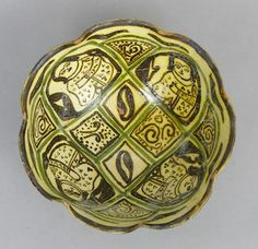 """A Ladies Bowl, Nishapur, 10th-12th Century Scalloped rim, earthenware with glaze, center depicting ladies in windows. Bottom with small foot. Approx. 3-3/8""""T x 8""""D."""