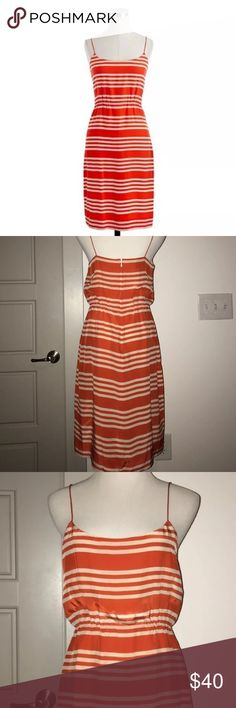 J. Crew Striated Stripes Dress J. Crew dress in gorgeous coral red and off white stripes, spaghetti straps, elastic at waist, 100% silkPerfect for a summer BBQ or your Fourth of July festivities! Easy to dress up for work with a simple Cardigan or blazer! EUC, no flaws to note. J. Crew Dresses