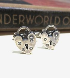 Bring a little extra attention (well deserved, we might add) to those dapper sleeves of yours with this set of love lock cufflinks. The tiny padlocks actually open, and the antiqued silver beauties are carefully attached to rhodium-plated swivel cufflinks. Slip the heart-shaped cufflinks into shirtsleeves for a dash of romance to your shirt.