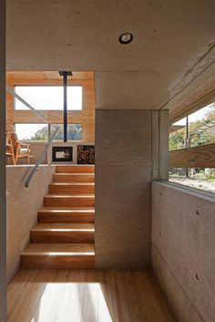 Partially underground NEST HOUSE by Japanese architecture firm UID, Onomichi City, Japan.