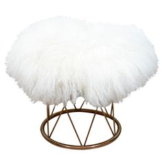 Fur covered brass stool