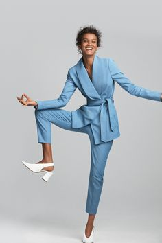 Traditional tailoring gets a 2017 reboot in the form of Liya Kebede wearing this two-piece trouser suit from Gestuz. Fusing a Japanese-style wrap jacket with tapered trouser legs, workwear just got wonderful. Gestuz Pant Suit; Högl Slingbacks