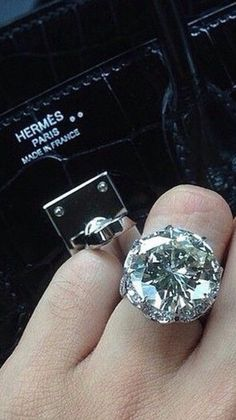 billionaires-vip-club:  Hermés and a very large rock on the engagement finger ….what more could a girl want?  @billionaires-vip-club  @aluxurylifestyle