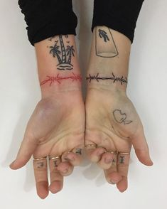 Barbed wire wrist tattoos
