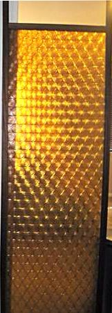 Mid-century tension pole room divider panel in amber.