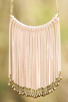 """Break Away"" from safe and mundane jewelry choices and take a chance on something bold. Rock this fringed beauty and you'll be wanting to make a statement (necklace) more often. Bib necklace features an antiqued gold chain and pendant wrapped with faux suede to create fringe. Length measures 16"" with 3"" extension."