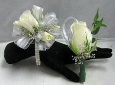 Sophisticated Lady Bracelet, White Stripe Ribbon, Silver Gyp, and White Spray Roses $33.49. For Him ~ White Rose Boutonniere with Matching Ribbon and Silver Gyp ~ $15.49 Homecoming Flowers, Homecoming Corsage, White Spray Roses, White Roses, White Rose Boutonniere, Wrist Corsage, Ribbon, Bracelet, Lady