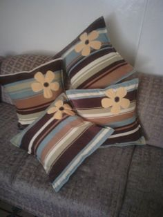 Fiber filled throw pillows with velvet cushion covers detailed with hand made flowers.