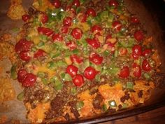 Nachos for movie night...doritos,browned meat with taco seasoning,tomatoes,green peppers,extra sharp cheddar cheese