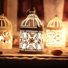 Birdcage candles plus more birdcage decor ideas to add some decorative flare hanging from a tree or as an outdoor table centerpiece. Add just one or two to your backyard or make plenty of them for wedding decor. #birdcages #ad #garden