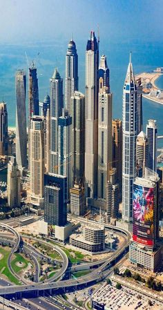 ʜᴏᴡ ʀɪᴄʜ ɪꜱ Dubai is one of the seven emirates in the United Arab Emirates, with the full name of the Emirate of Dubai, United Arab Emirates, and it is located in the Middle East. Dubai is a country built in the desert. Dubai Buildings, Famous Buildings, Amazing Buildings, Modern Buildings, Dubai City, Dubai Mall, Dubai Hotel, Unique Architecture, Futuristic Architecture