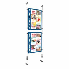 Holders to display advertising posters or information on walls, clear acrylic (plastic) poster holders suspended on wires fixed to the wall.