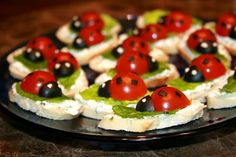 Ladybugs Appetizer - Start with a cracker, cucumber slice or small slice of bread, add a smear of cream cheese, small slice of smoked salmon, snip of cilantro or parsley, 1/2 cherry or grape tomato, and sliver of black olive