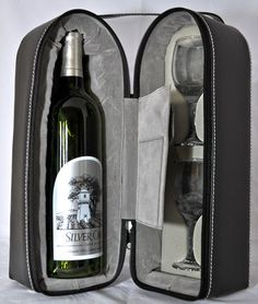 This #leatherette, zippered soft #case holds a #bottle of wine in a well padded compartment (bottle not included) 2 #glasses (included) in velvet foam forms. The sewn-in pouch can hold a #corkscrew in the open pocket #foil #cutter in the Velcro closed pouch on the opposite side. (Corkscrew and foil cutter are not included in the price). #Carrying strap. Four metal studs at the base. Stands 13-1/2 tall, 7-3/8, 4-3/8 deep. Add a #bottle of #wine Great #Birthday or #Special #Occasion #Gift!