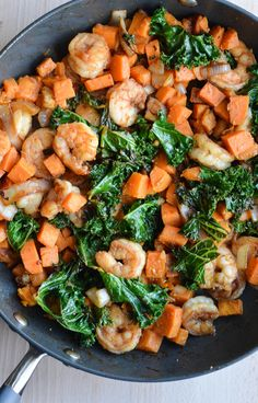Shrimp & Spicy Kale Sweet Potato Stir-Fry. -- Delicious flavors combined to create one yummy stir-fry.
