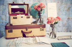 suitcases, globe, vases of flowers