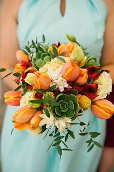 Orange tulip and succulent bridal bouquet for a modern wedding.