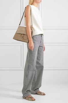 Gray leather and suede (Calf) Snap-fastening front flap Designer color: Motty Gray  Comes with dust bag Weighs approximately 2.4lbs/ 1.1kg Made in Italy
