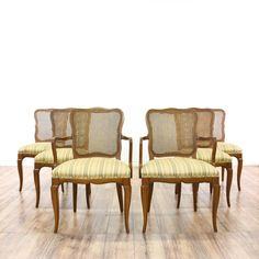 """This set of 6 """"R-Way"""" dining chairs is featured in a solid wood with a glossy oak finish. Each traditional style side chair has a caned back, striped upholstered seat, and scalloped trims. Charming chairs that are perfect for any dining room! #americantraditional #chairs #diningchair #sandiegovintage #vintagefurniture"""