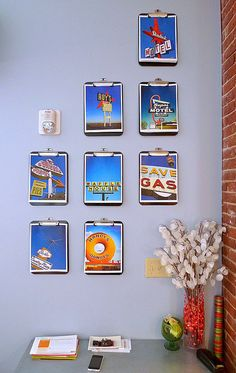 Clipboard wall.  A great way to display random rotating photos or photos that follow a theme.  Notice how the poster worked with the fire alarm?