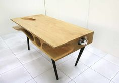 Here's a very interesting piece of furniture design that's oh so very Hauspanther. It's the CATable designed by Ruan Hao from the Hong Kong-based architecture firm LYCS. This elegant modern table is filled with passageways and hideouts for cats to. Pet Furniture, Furniture Design, Furniture Ideas, Wooden Furniture, Table Furniture, Wood Table, A Table, Dining Tables, Creative Inventions